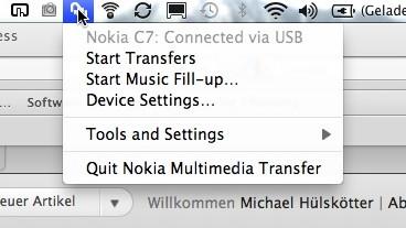 Das Nokia Transfer Multimedia Tool klinkt sich in der Taskleiste von Mac OS X ein